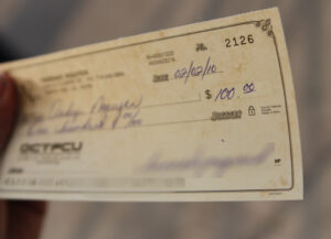 Signed paycheck that leads to songs about payday.