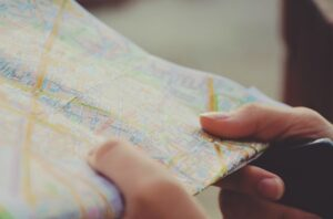 Traveling employee studies map using map app.