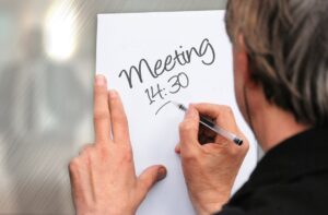 Professional tracking time spent for meeting.