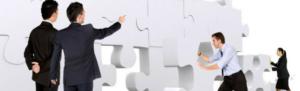 Employees use teamwork to build a puzzle, symbolizing employee engagement.