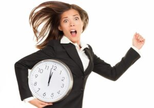 A tardy employee holding a clock rushes to work.