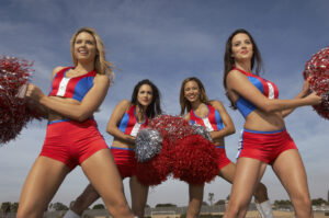 Portrait of team of cheerleaders as one cheerleader sues her team for violating the FLSA.