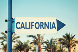 California sign pointing to payroll with FingerCheck360.