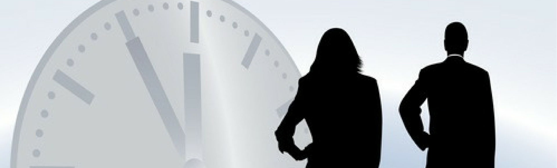 Shadowy figures of businessman businesswoman standing in front of large time clock signifying time worked whether it's part-time or full-time, and the need for staffing solutions.
