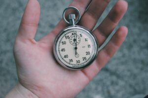 Rusted pocket watch held in hand signifying outdated time tracking practices to stop holding onto.