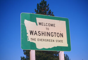 Welcome to Washington sign signifying Fingercheck adding Washington to covered payroll states.