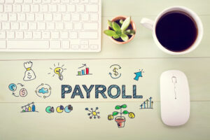 Keyboard, succulent, coffee cup, mouse, with PAYROLL illustrated on backdrop and currency, chart, and financial doodles surrounding for payroll advice.