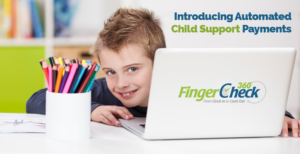 Boy in playroom grins from behind laptop at the news of Fingercheck's automatic child support payment options.