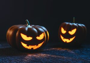 Two sinisterly grinning jack-o-lanterns at the wage and hour violations that terrify us.