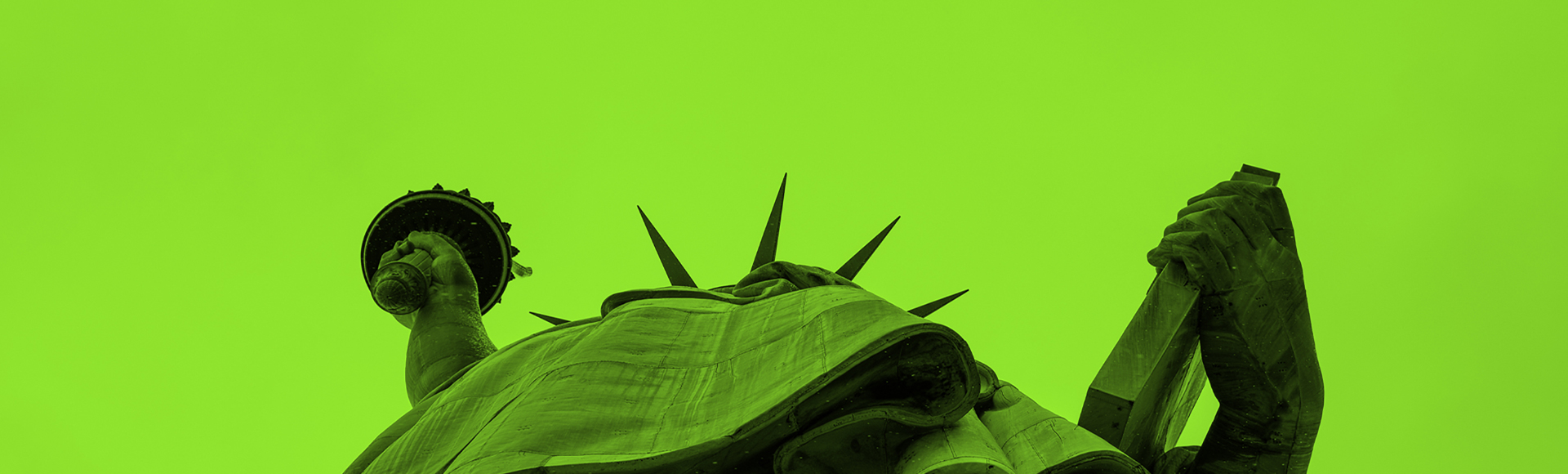 Close-up of Statue of Liberty's crown symbolizing liberty as New York bans employers from asking job applicants about pay history.