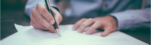 Independent contractor signing a contract deal confirming his hire agreement and worker classification.