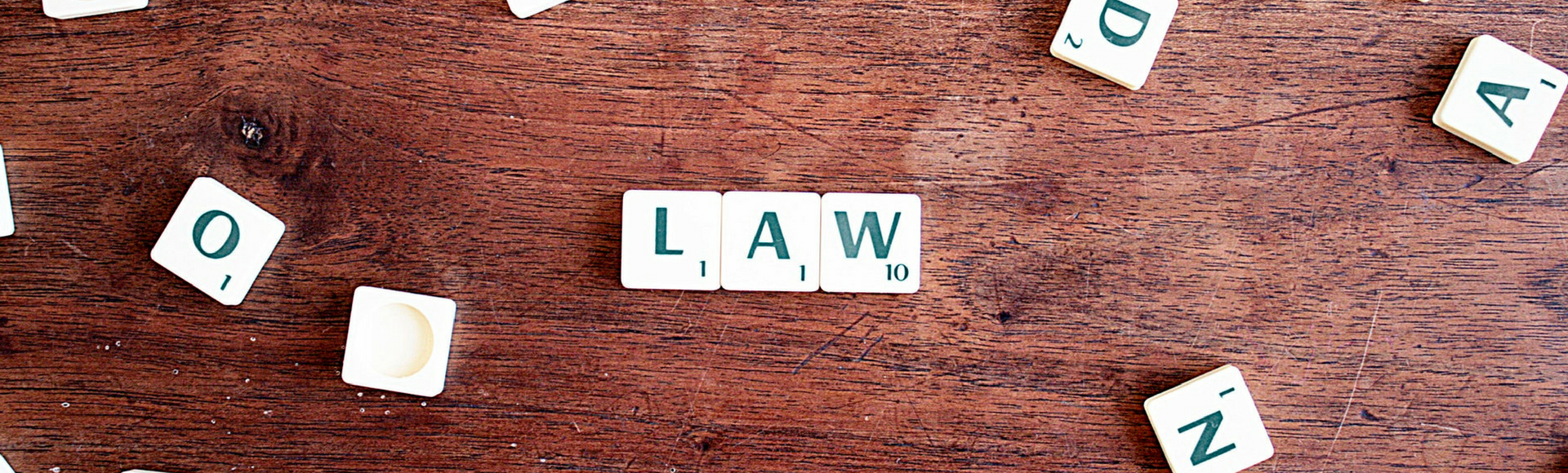 "Scrabble tired spell ""Law"" in reference to jury duty pay requirements employers need to know."